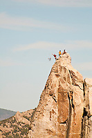 "Climbers prepare to rap off the top of Morning Glory Spire, after climbing ""Skyline"" City of Rocks National Reserve, Idaho."
