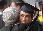 Graduate Andrew Banda is hugged by Nancy Henry before commencement at Rice University Saturday mornging May 09,2009.(Dave Rossman/For the Chronicle)