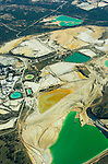 Clay and silica sand open pit mines and ponds south of town from the air near Ione, Calif.