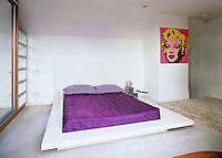 The Japanese-style bedroom has a built-in mirrored wardrobe and drawers and a screen print by Andy Warhol