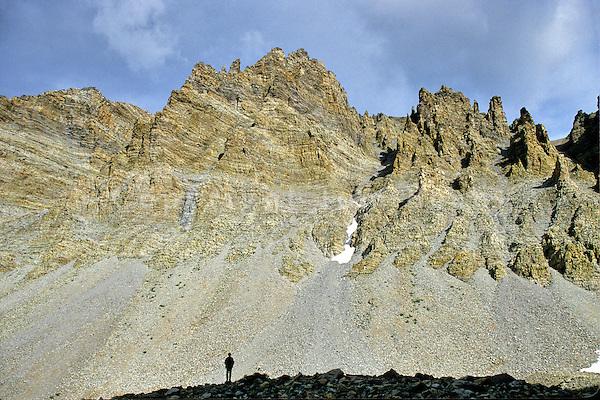 Hiker views talus slopes in The Cirque below Wheeler Peak, at Great Basin National Park, Nevada, USA, AGPix_1925