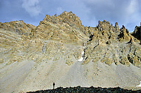 Hiker views talus slopes in The Cirque below Wheeler Peak, at Great Basin National Park, Nevada, USA, AGPix_1925