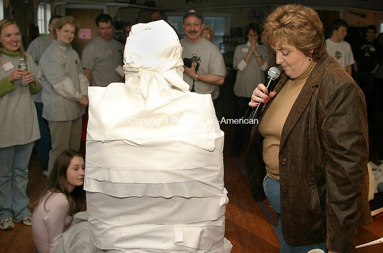 WOODBURY, CT- 27 FEBRUARY 2005-022705J11 Tina Walewski, right, judges how well a team dressed Jen Vagnini, 16, of Woodbury as a mummy during the 'Ultimate Games' held Sunday at the Voegli Miniature Horse Farm in Woodbury. The event, in which local high school students face off in a series of challenges, was sponsored by the Woodbury's church communities and presented by St. Teresa of Avila Church. --- Jim Shannon Photo--St. Teresa of Avila Church; Voegli Miniature Horse Farm; Woodbury; Tina Walewski, Jen Vagnini are CQ