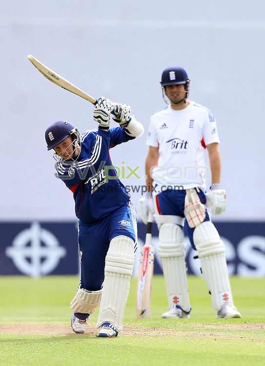 PICTURE BY VAUGHN RIDLEY/SWPIX.COM - Cricket - England v New Zealand, 2nd Test - England Nets - Headingley, Leeds, England - 22/05/13 - England's Joe Root hits out under the eye of Captain Alastair Cook.