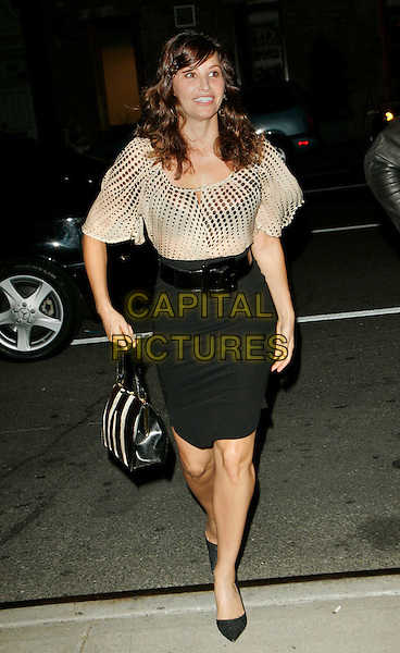 "GINA GERSHON.At a special screening of ""The Black Dahlia"" at the Tribeca Grand, New York, NY, USA..September 13th, 2006.Ref: ADM/JL.full length black skirt white sheer clouse belt bag purse.www.capitalpictures.com.sales@capitalpictures.com.©Jackson Lee/AdMedia/Capital Pictures."