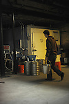 Matthew Gallagher, 31, an engineer, carries equipment in the Half-Acre Beer Company's brew house at 4257 N. Lincoln Ave. in Chicago, Illinois on June 13, 2009.
