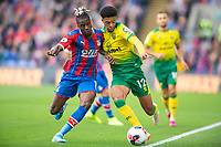 Norwich City Jamal Lewis and Crystal Palace Wilfried Zaha during the Premier League match between Crystal Palace and Norwich City at Selhurst Park, London, England on 28 September 2019. Photo by Andrew Aleksiejczuk / PRiME Media Images.