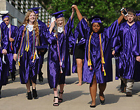 NWA Democrat-Gazette/ANDY SHUPE<br /> Best friends Allison Graham (center) and Deveny Walls (right), both graduating seniors at Fayetteville High School, celebrate Thursday, May 18, 2017, as they walk hand in hand into Bud Walton Arena before taking part in the school's commencement exercises. Visit nwadg.com/photos to see more photographs from the ceremony.