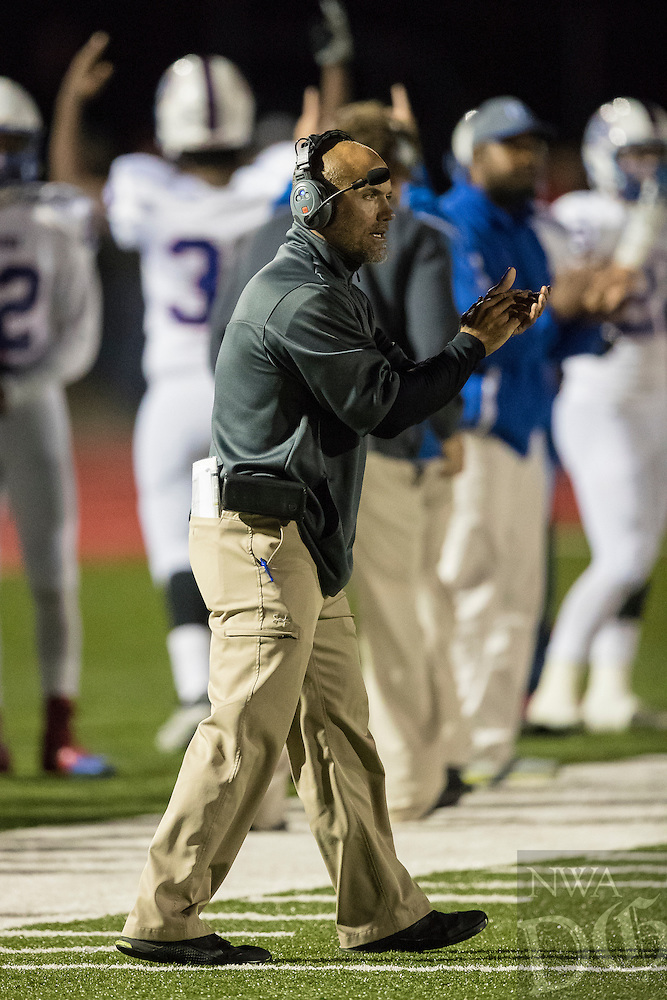Arkadelphia head coach J.R. Eldridge claps his hands after his team scores a touch down in the first round of the class 4A playoffs at Balckhawk Field in Pea Ridge