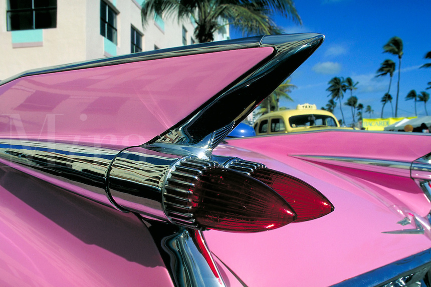 Detail of pink Cadillac taillight and tail fin seen during the famous Art Deco weekend celebration in Miami, Florida. Classic cars. Miami Florida, Art Deco weekend.