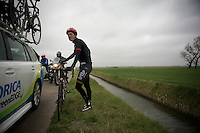Lars Bak (DEN/Lotto-Soudal) crashed in De Moeren; blown off his bike by +80km/h winds. Almost all teamcars have passed (including his) and doesn't really know where to go next. Into the broom wagon (with bike)...<br /> <br /> 77th Gent-Wevelgem 2015