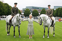 22/7/2010. Mary Hanafin TD, Minister for Tourism, Culture and Sport is pictured with Capt David Power and Capt David O Brien members of the army Equitation School with River Foyle and Lough Foyle at the RDS for the launch of the 2010 Fáilte Ireland Dublin Horse Show. Picture James Horan/Collins Photos