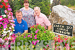 Currow  village is looking its best for the judging of the Pride of Place competition this week. .L-R Peter O'Connor, Marian and Billy Boyle.