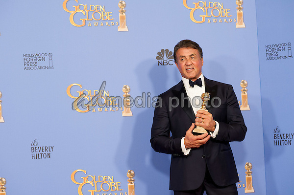 "After winning the category of BEST PERFORMANCE BY AN ACTOR IN A SUPPORTING ROLE IN A MOTION PICTURE for his work in ""Creed,"" actor Sylvester Stallone poses backstage in the press room with his Golden Globe Award at the 73rd Annual Golden Globe Awards at the Beverly Hilton in Beverly Hills, CA on Sunday, January 10, 2016. Photo Credit: HFPA/AdMedia"