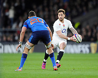 Danny Cipriani of England looks to sidestep Damien Chouly of France