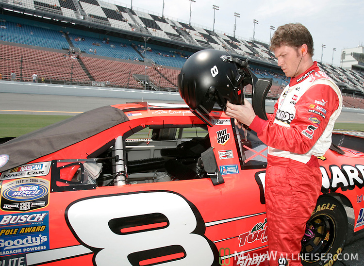 Dale Earnhardt Jr. prepares to get into his #8 Chevrolet to qualify for the Winn-Dixie 250 Busch Series NASCAR race at Daytona International Speedway in Daytona Beach, Florida June 30, 2006.