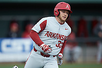 Grant Koch (33) of the Arkansas Razorbacks hustles down the first base line against the Charlotte 49ers at Hayes Stadium on March 21, 2018 in Charlotte, North Carolina.  The 49ers defeated the Razorbacks 6-3.  (Brian Westerholt/Four Seam Images)