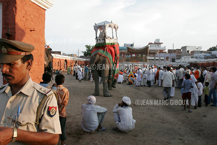 .RAMNAGAR, UTTAR PRADESH, INDIA - SEPTEMBER 22, 2005 : The Maharaja of Benares watches the performance of the Ramlila from the top of his elephant on day # 6 of the Ramlila in Ramnagar, on September 22, 2005. The Ramlila is the play of the Hindu scripture 'the Ramayana', writen by Tulsidas in Varanasi, which depict the adventures of the god Ram and his flight aginst the Demon God Ravana. The Ramlila of Ramnagar has been organized by the Maharaja of Benares since the early 1800s and is still the most authentic, a reference to other Ramlilas. It last for 31 days and is performed over a 10 square mile area . It is the largest theatrical production in the world ..(Photo by Jean-Marc Giboux)