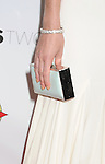 HOLLYWOOD, CA - AUGUST 23: Lizzy Caplan (handbag, diamond bracelet detail) at the Los Angeles premiere of 'Bachelorette' at the Arclight Hollywood on August 23, 2012 in Hollywood, California.
