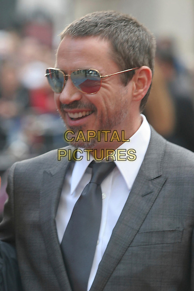 "ROBERT DOWNEY JR. .Attending the ""Iron Man"" UK Film Premiere at the Odeon, Leicester Square, London, England, .24th April 2008..portrait headshot beard stubble smiling sunglasses grey gray tie .CAP/DS.©Dudley Smith/Capital Pictures"