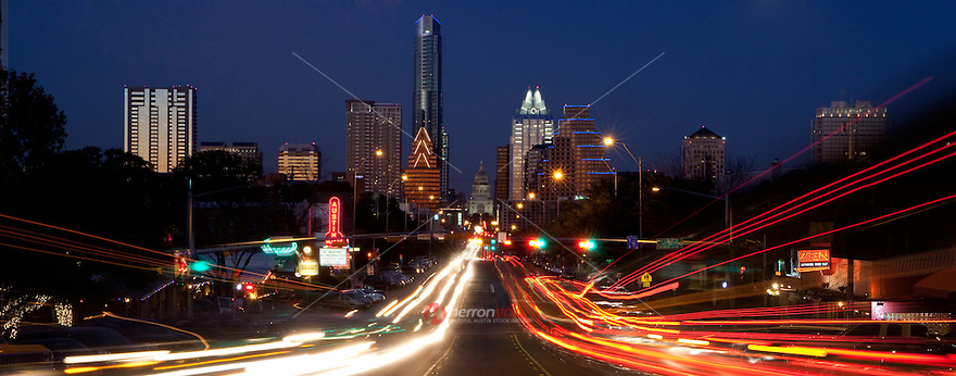 Panoramic view of downtown Austin Skyline with night traffic light trail from South Congress (Soco) view