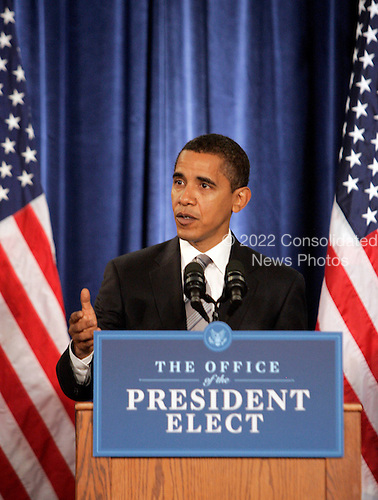 Chicago, IL - November 26, 2008 -- United States President-elect  Barack Obama gestures during a news conference Wednesday, November 26, 2008, in Chicago, Illinois. .Credit: Frank Polich - Pool via CNP