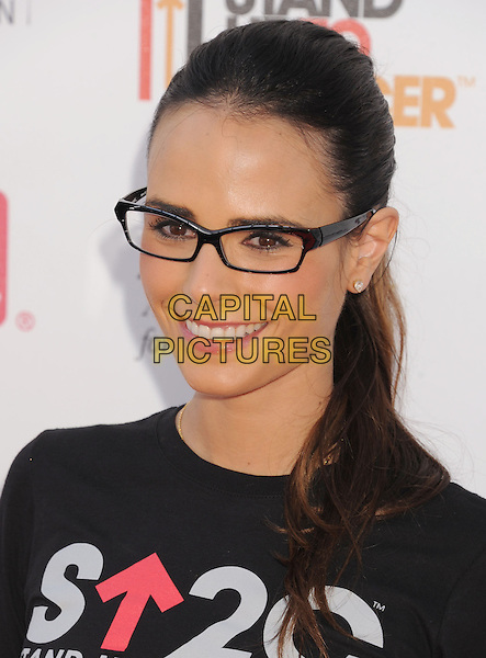 Jordana Brewster.arriving at Stand Up To Cancer at The Shrine Auditorium in Los Angeles, California, USA, September 7th, 2012.  .portrait headshot black t-shirt smiling hair up ponytail  glasses  .CAP/ROT/TM.©Tony Michaels/Roth Stock/Capital Pictures