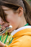Close up of flute player age 15. MayDay Parade and Festival. Minneapolis Minnesota USA