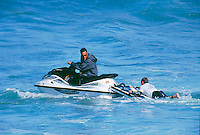 Bells Beach, Torquay, Victoria, Australia.Vetea David (PYF) ferries Taylor Knox (USA) back to the take off position on the back of a Jet Ski during the running of the 2001 Rip Curl Pro at Bells Beach over the Easter holiday period. The contest was won by the late Hawaiian surfer Andy Irons (HAW). It was first time jet ski's had been used  to assist surfers in  World Championship Tour (WCT) events.<br /> Photo joliphotos.com