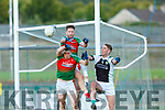 Kevin Gorman Kilcummin  rises over team mate Damien O'LEary and Legions Billy McGuire to clear the ball  during their SFC game in Lewis Road  Killarney Saturday evening