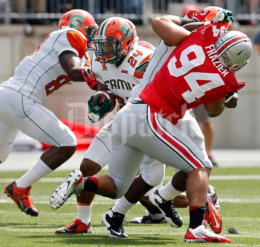 Florida A&M Rattlers running back Lemond Buice (24) finds a hole to run up against Ohio State Buckeyes defense in the 2nd quarter during their college football game at Ohio Stadium on September 21, 2013.  (Dispatch photo by Kyle Robertson)