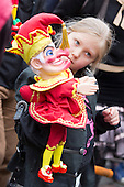 Covent Garden, London, UK. 11 May 2014. The festival starts with a procession around the streets of Covent Garden. A girl carries a Mr Punch puppet. The Covent Garden May Fayre and Puppet Festival takes place at St Paul's Church.