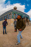 Arab boys playing soccer in the courtyard in front of The Dome of the Rock on the Temple Mount,  Jerusalem, Israel