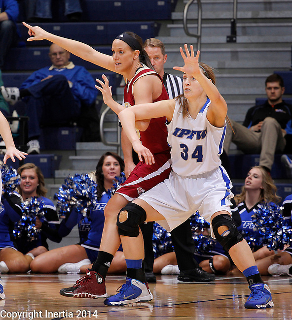 SIOUX FALLS, SD - MARCH 9:  Alison Janecek #42 of Devner gets defended by Rebecca Bruner #34 of IPFW during their quarterfinal game at the 2014 Summit League Basketball Championships Sunday at the Sioux Falls Arena.  (Photo by Dick CarlsonInertia)