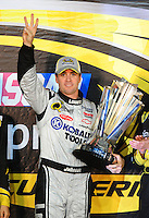 Nov. 16, 2008; Homestead, FL, USA; NASCAR Sprint Cup Series driver Jimmie Johnson celebrates after winning the 2008 championship following the Ford 400 at Homestead Miami Speedway. Mandatory Credit: Mark J. Rebilas-