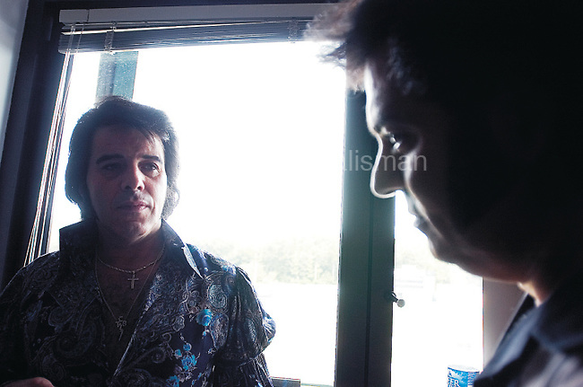 The Gazette Tony Grova (left) of Ringwood, New Jersey talks with fellow Elvis, Dr. Nazar J Sayegh of Scarsdale, New York in the dressing room before they perform at the Ultimate Elvis Tribute Contest at Prince George's Stadium in Bowie on Saturday afternoon.