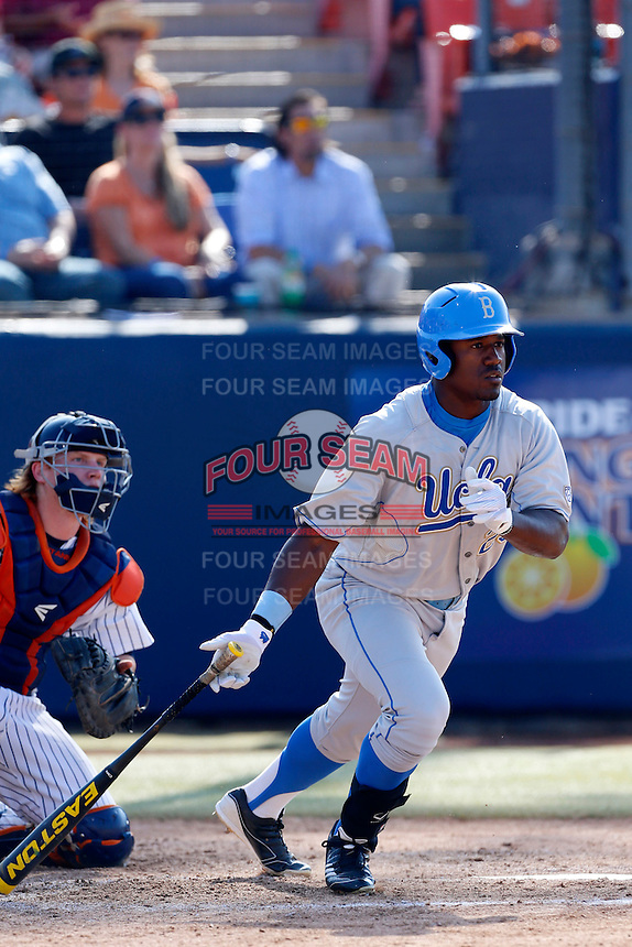 Brenton Allen #23 of the UCLA Bruins bats while being watched by Chad Wallach #29 of the Cal State Fullerton Titans during the NCAA Super Regional at Goodwin Field on June 7, 2013 in Fullerton, California. UCLA defeated Cal State Fullerton, 5-3. (Larry Goren/Four Seam Images)