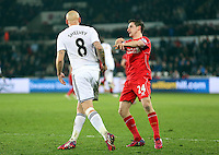SWANSEA, WALES - MARCH 16: Joe Allen of Liverpool (L) pushes over Jonjo Shelvey of Swansea (L) during the Premier League match between Swansea City and Liverpool at the Liberty Stadium on March 16, 2015 in Swansea, Wales