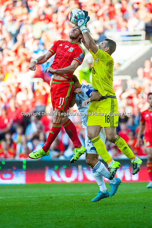 Ofir Marciano of Isreal  catches the ball from Gareth Bale  of Wales' head during their UEFA EURO 2016 Group B qualifying round match held at Cardiff City Stadium, Cardiff, Wales, 06 September 2015. EPA/DIMITRIS LEGAKIS