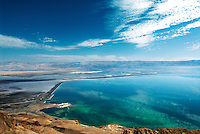 The Dead Sea is a salt lake bordering Jordan and Israel. At around 1,300 ft below sea level, it is Earth's lowest elevation. In recent decades, the Dead Sea has been rapidly shrinking because of natural evaporation and the diversion of incoming water from the Jordan River. Many people believe that the mud of the Dead Sea has special healing and cosmetic uses.