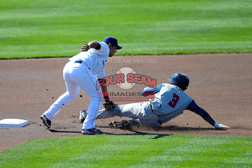 Columbus Clippers second baseman Luis Hernandez #7 tags out Gustavo Nunez #3 sliding into third during a game against the Toledo Mudhens on April 22, 2013 at Huntington Park in Columbus, Ohio.  Columbus defeated Toledo 3-0.  (Mike Janes/Four Seam Images)