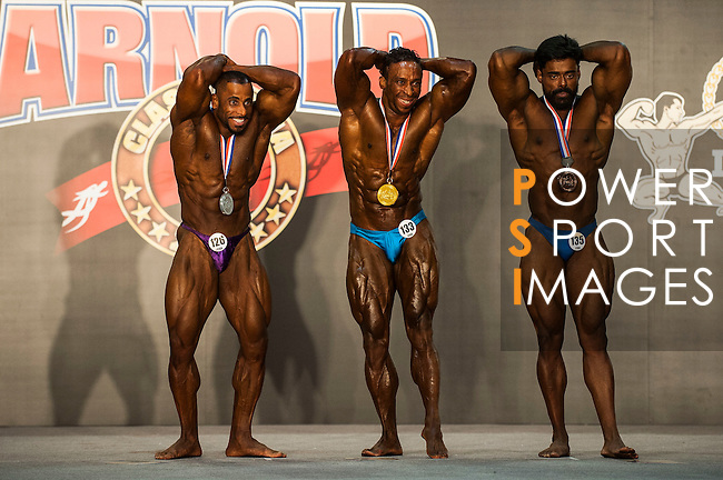 (L-R) Alamos Moosa Ali of United Emirates, Omar Khalid of Morocco and Arvin Ravikouar of India flex their muscles in the Arnold Classic Mens Bodybuilding during the Arnold Classic Asia 2016 Multi-Sport Festival on 20 August 2016 at the AsiaWorld-Expo, Hong Kong. Photo by Marcio Machado / Power Sport Images