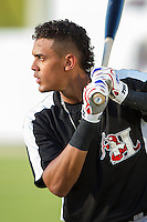 Ronald Guzman (22) of the Hickory Crawdads warms up in the outfield prior to the game against the Kannapolis Intimidators at CMC-Northeast Stadium on May 5, 2014 in Kannapolis, North Carolina.  The Intimidators defeated the Crawdads 5-2.  (Brian Westerholt/Four Seam Images)