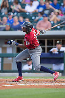 Darnell Sweeney (24) of the Lehigh Valley Iron Pigs follows through on his swing against the Charlotte Knights at BB&T BallPark on June 3, 2016 in Charlotte, North Carolina.  The Iron Pigs defeated the Knights 6-4.  (Brian Westerholt/Four Seam Images)
