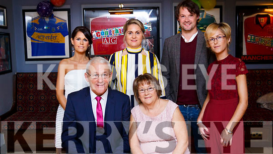 RETIRED: Maurice Leahy, who has retiring after 37 years as Games Development Administrator with the Kerry County GAA Committee, pictured with his family at his retirement party in The Stretford End Bar, Causeway, on Saturday, seated front Maurice and Carmel Leahy with their children, standing l-r: Avril Maloney, Sharon Dooley, David Leahy, and Carol Leahy.