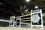 Daniel Deusser on Clintop competes during Longines Grand Prix at the Longines Masters of Hong Kong on 21 February 2016 at the Asia World Expo in Hong Kong, China. Photo by Juan Manuel Serrano / Power Sport Images