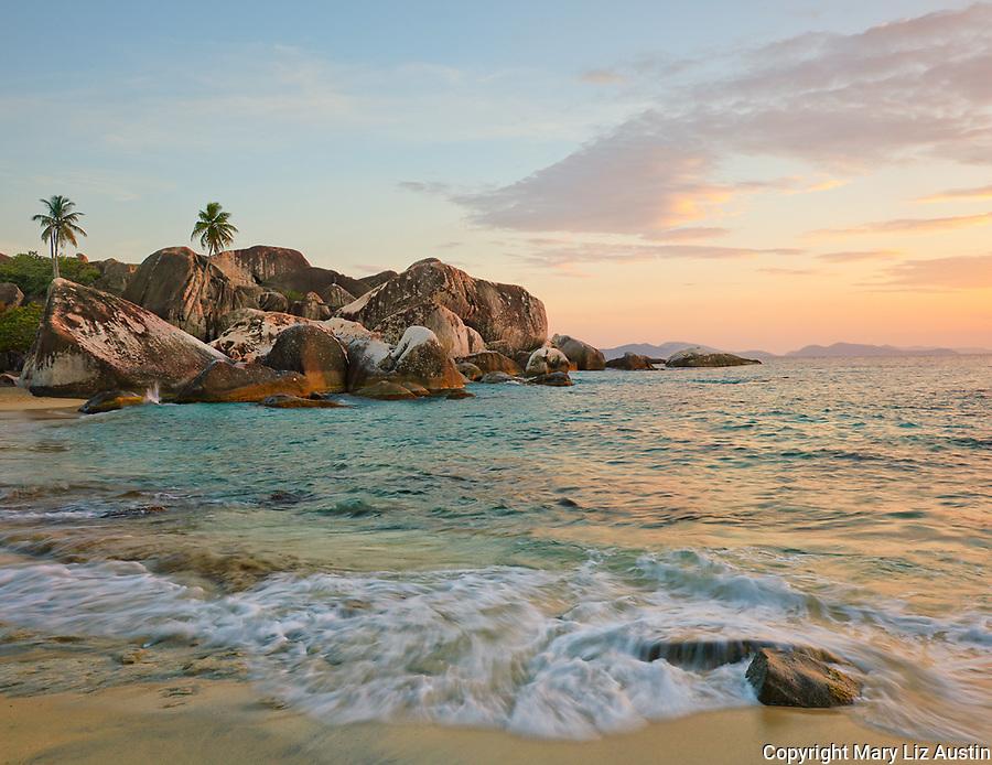 Virgin Gorda, British Virgin Islands, Caribbean <br /> Waves washing the sandy shoreline of The Baths National Park at sunset.