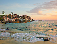 Virgin Gorda, British Virgin Islands, Caribbean <br /> Waves washing the sandy shoreline of The Baths National Park at sunset.