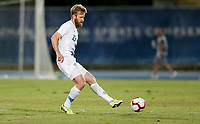 GEORGETOWN, GRAND CAYMAN, CAYMAN ISLANDS - NOVEMBER 19: Tim Ream #13 of the United States passes off the ball during a game between Cuba and USMNT at Truman Bodden Sports Complex on November 19, 2019 in Georgetown, Grand Cayman.