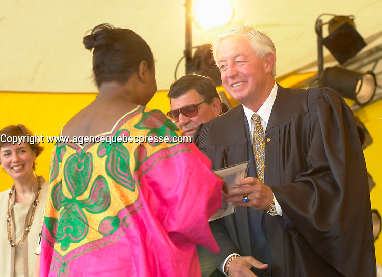 July 1 2002, Montreal, Quebec, Canada<br /> <br /> An African Woman  receive her Canadian citizenship,<br /> from Jean Beliveau, Ceremonies President,<br />  in an official ceremony, July 1st 2001, in the Old-Port of Montreal. No Model Release <br /> <br /> Mandatory Credit: Photo by Pierre Roussel- Images Distribution. (&copy;) Copyright 2002 by Pierre Roussel
